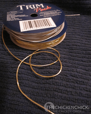 elastic cording can be used to hang blown, decorated eggshells