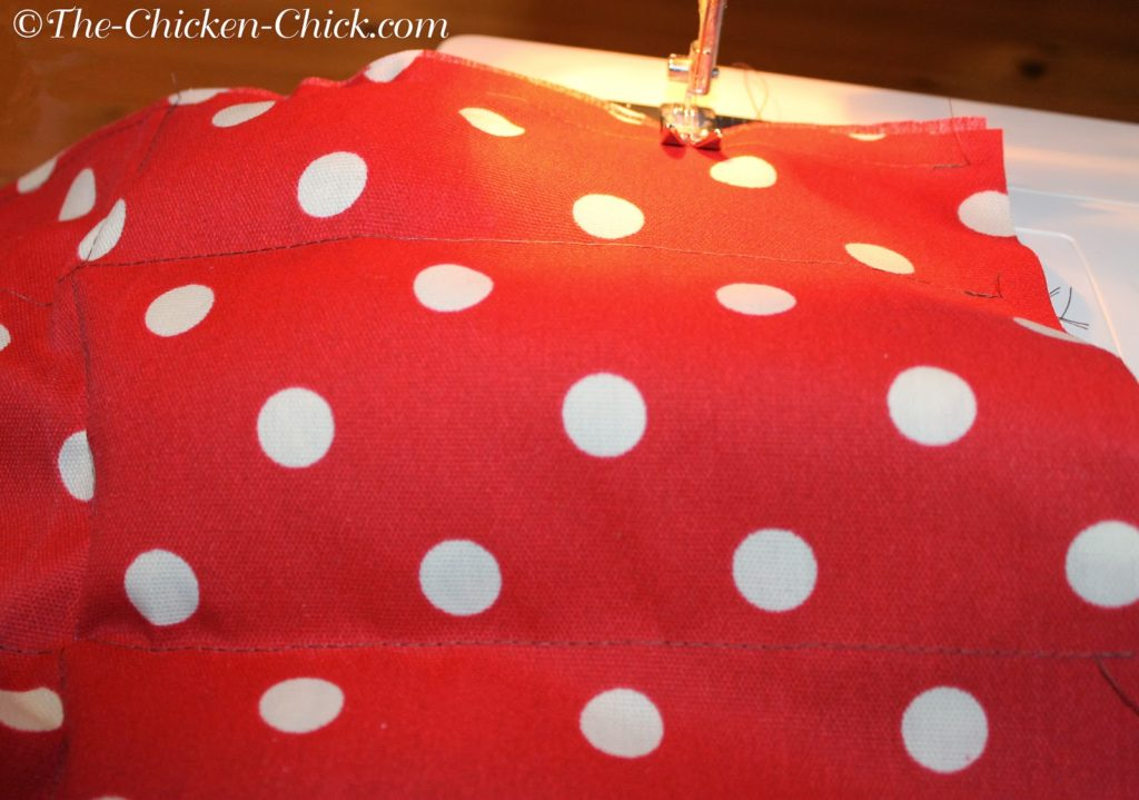 Make 4 pockets: From the open end of the fabric, sew a straight line down to the opposite side, repeat two times so that there are four long pockets created.